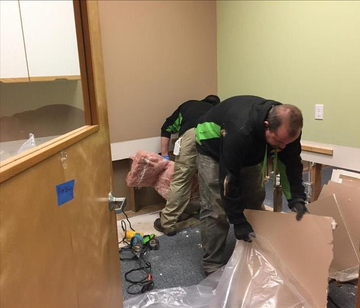 SERVPRO technicians removing drywall