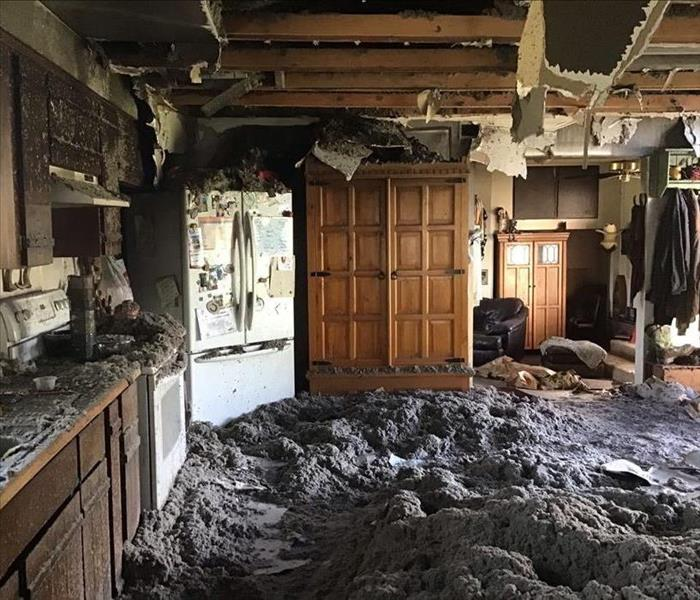 Severe water damage causes the kitchen ceiling to collapse