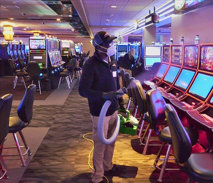 SERVPRO technician fogging a casino for a commercial cleaning job