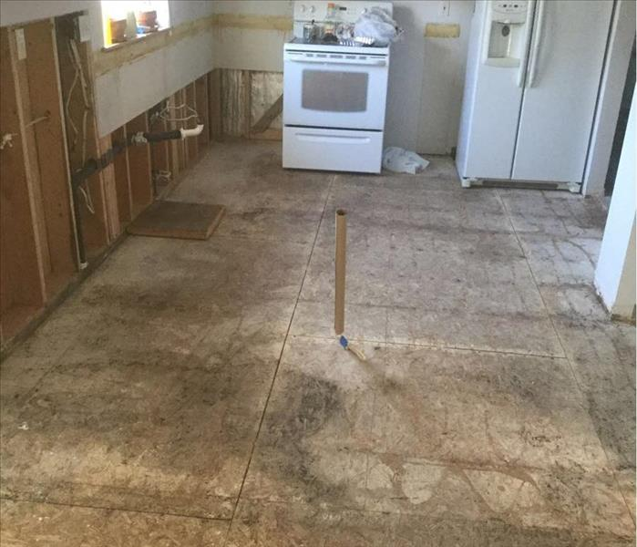 Water damage on the floor from flooding