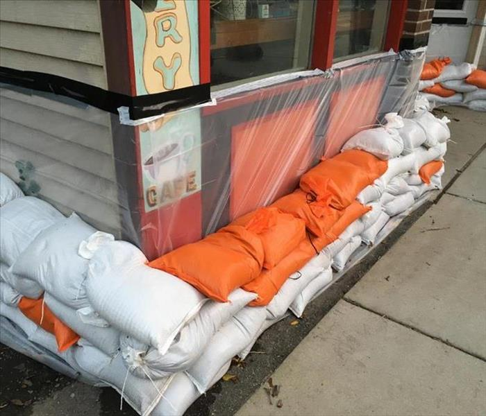 Sand bags surrounding the outside of a store